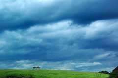 Grassland. Dark clouds rolling grasslands, the coming storm Stock Images