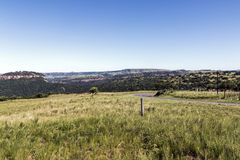 Grassland Against Distand Hills and Blue Sky Landscape Royalty Free Stock Images