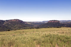 Grassland Against Distand Hills and Blue Sky Landscape Royalty Free Stock Photo