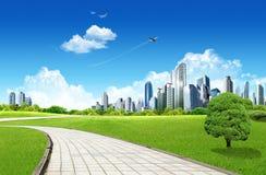 Grassland with city Stock Photos