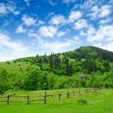 Grassland with fence and rural house Royalty Free Stock Photography