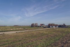 Grassland and houses of Oudeschild. At Texel island on sunny october day stock photography