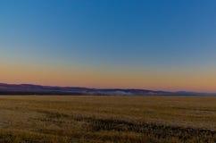 Grassland at late autumn morning Stock Photo