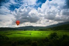 Grassland rising hot air balloon Stock Photo