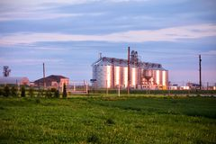 Grassland with silos at the background in Lithuania stock photo