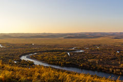 Grassland and wetland in the sunset Stock Photos