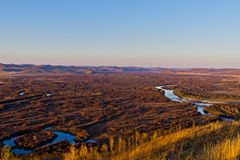 Grassland and wetland in the sunset Stock Photo
