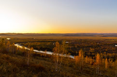 Grassland and wetland in the sunset Stock Images