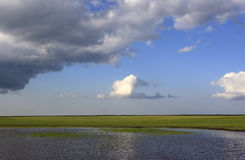 Grasslands, lakes, the sky, the clouds Stock Image