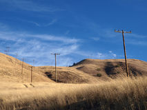 Grasslands and Phone Poles. Ranch grasslands and telephone poles in Chatsworth California Stock Photography