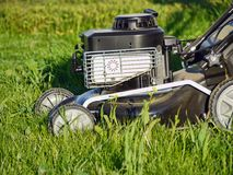 Grassmower. Closeup of grassmower in the grass Stock Image