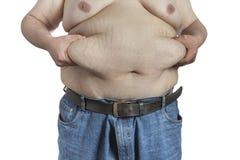 Grasso ipinching della pancia dell'uomo di peso eccessivo immagini stock