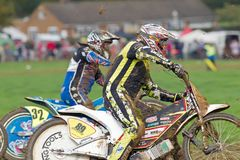 Grasstrack riders competing. ALVELEY, UK - OCTOBER 1: A pair of solo riders competing in the autumn grasstrack meeting hosted by Bewdley MCC take the bottom Stock Photo