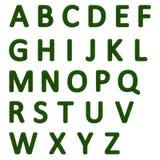 Grassy alphabet. Isolated 3d grassy letters (alphabet Royalty Free Stock Photo