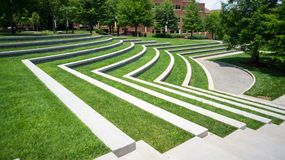 Grassy Amphitheatre. A grassy Amphitheatre with trees on the e Stock Photography