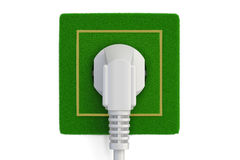 Grassy electric socket with plug, green energy concept. 3D  Royalty Free Stock Photos