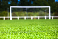 Grassy Field And Goal Post On Sunny Day Stock Photo
