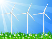 Grassy field and wind generator Stock Images