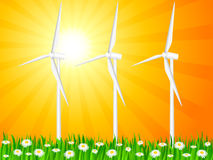 Grassy field and wind generators Royalty Free Stock Image