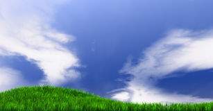 Grassy Hill And Blue Sky Stock Photo