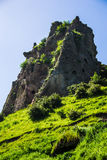 Grassy hill, cave city vertical Stock Images