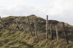 Grassy hill with rickety barbed wire fence, Connemara Stock Image