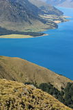 Grassy hills above lake Hawea. In New Zealand Royalty Free Stock Images