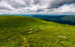 Grassy hills on a cloudy day in Carpathians. Beautiful mountain landscape in summer Royalty Free Stock Photos