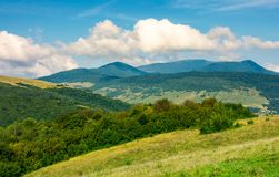 Grassy hills and distant mountain peaks. Lovely countryside landscape of carpathians stock images