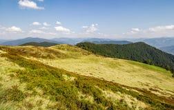 Grassy hills of mountain ridge in autumn. Grassy hills of wide mountain ridge. beautiful autumn nature background Royalty Free Stock Photos