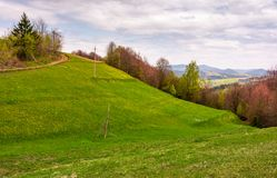 Grassy hills of mountainous rural area. Beautiful countryside landscape in springtime on a cloudy day Stock Photography