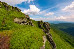 Grassy hillside with boulders. Lovely summer landscape of Carpathian mountain Stock Images