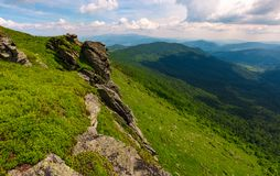 Grassy hillside with boulders. Lovely summer landscape of Carpathian mountain Stock Photos