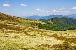 Grassy hillsides on mountain ridge Stock Photography