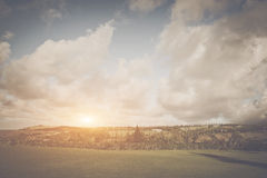 Grassy Landscape with Large Clouds Stock Photos