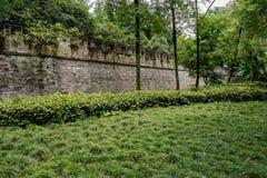Grassy lawn before ancient brick wall Royalty Free Stock Photo