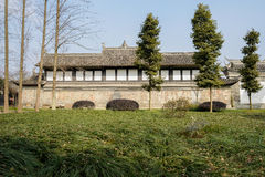 Grassy lawn before ancient Chinese building in sunny spring Stock Photo