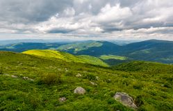 Grassy meadow on hillside on a cloudy day. Beautiful mountainous landscape in summertime. location Runa mountain, Ukraine Royalty Free Stock Images