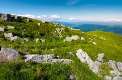 Grassy meadow with rocky formations in mountains. Lovely summer landscape. location Runa mountain, Carpathians, Ukraine Stock Photo