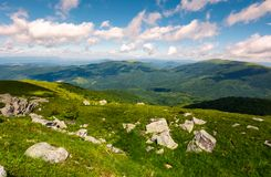Grassy meadow with rocky formations in mountains. Lovely summer landscape. location Runa mountain, Carpathians, Ukraine Royalty Free Stock Photography