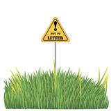 Grassy meadow on a white background with a sign. Do not litter.for web design Stock Image