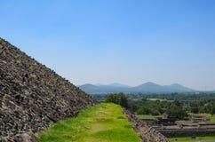 Grassy pathway and closeup of pyramid's wall at Teotihuacan Royalty Free Stock Photo