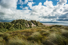 Grassy sand dunes stormy skies Royalty Free Stock Photos