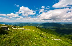 Grassy slope of the mountain on a cloudy day. Beautiful summer landscape of Carpathian mountains Stock Photo