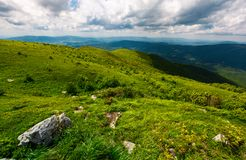 Grassy slope of the mountain on a cloudy day. Beautiful summer landscape of Carpathian mountains Stock Photos
