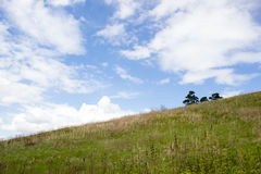 Grassy slope and sky Royalty Free Stock Images