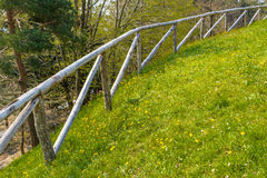 Grassy slope and wooden fence Royalty Free Stock Photography