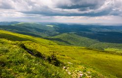 Grassy slopes of Carpathians before the storm. Beautiful mountainous landscape in summertime Royalty Free Stock Photo