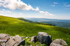 Grassy slopes with huge rocks. Beautiful mountainous landscape in summertime. location mountain Runa, TransCarpathian region of Ukraine royalty free stock photos