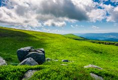 Grassy slopes with huge rocks. Beautiful mountainous landscape in summertime. location mountain Runa, TransCarpathian region of Ukraine stock photography